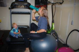 Neely trains at home with her son.