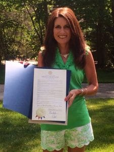 Doctors told Connie there was nothing wrong with her. A friend helped solve the mystery. Connie is shown here with the official Tennessee proclamation of Lyme Disease Awareness Month (May).