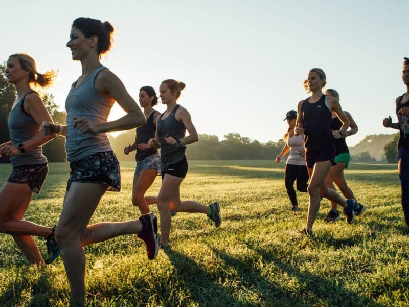 women running in field