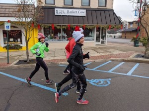 Andi & Zach Ripley of atozrunn.com don Santa hats on their run together.